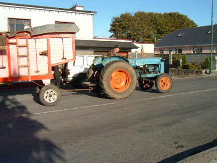 Johnny Delaney drives his threshing machine through Williamstown as part of the vintage car and tractor parade