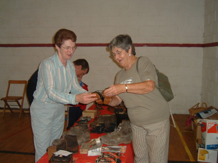 Heritage Day 2004 Mary Feeney and Maureen Lyons looking at part of the indoor heritage display showing old boots and shoes of yesteryear