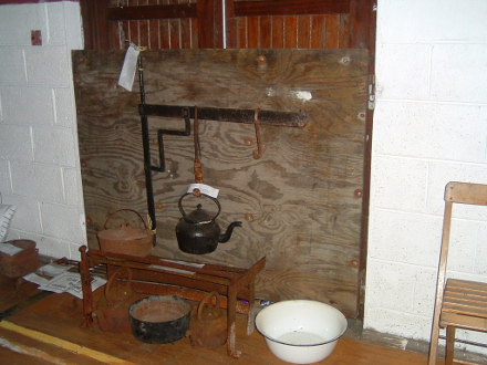 The old crane and crooks, kettles, oven and basin at the old fireside